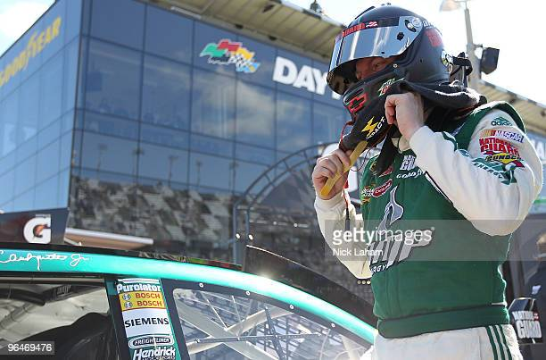 Dale Earnhardt Jr driver of the AMP Energy Chevrolet climbs from his car after qualifying for the Daytona 500 at Daytona International Speedway on...