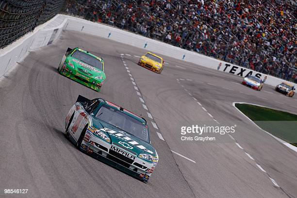 Dale Earnhardt Jr driver of the AMP Energy / National Guard Chevrolet leads Kyle Busch driver of the Interstate Batteries Toyota during the NASCAR...
