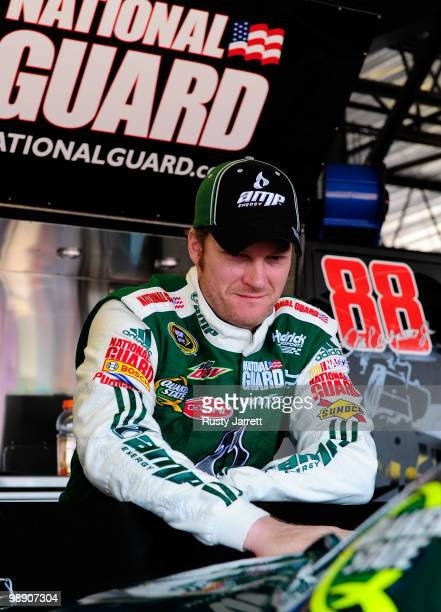 Dale Earnhardt Jr driver of the AMP Energy / National Guard Chevrolet looks on in the garage during practice for the NASCAR Sprint Cup Series...
