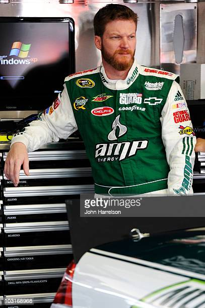 Dale Earnhardt Jr driver of the AMP Energy/National Guard Chevrolet stands in the garage during practice for the NASCAR Sprint Cup Series Sunoco Red...