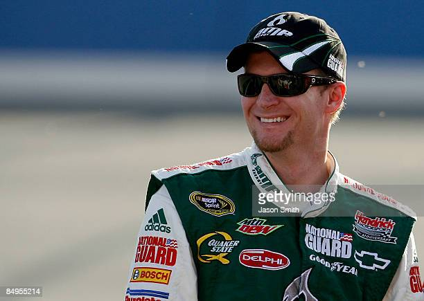 Dale Earnhardt Jr., driver of the Amp Energy/National Guard Chevrolet, stands on the grid during qualifying for the NASCAR Sprint Cup Series Auto...