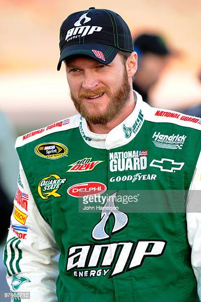 Dale Earnhardt Jr driver of the AMP Energy/National Guard Chevrolet stands on the grid during qualifying for the NASCAR Sprint Cup Series Kobalt...
