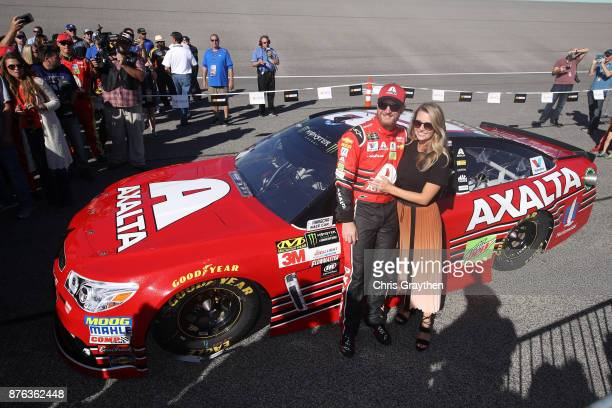 Dale Earnhardt Jr driver of the AXALTA Chevrolet and Amy Earnhardt pose for a photo prior to the Monster Energy NASCAR Cup Series Championship Ford...