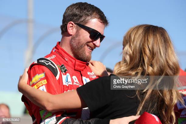 Dale Earnhardt Jr driver of the AXALTA Chevrolet and his wife Amy during prerace ceremonies for the Monster Energy NASCAR Cup Series Championship...