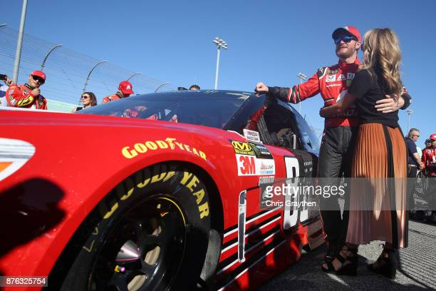 Dale Earnhardt Jr driver of the AXALTA Chevrolet and his wife Amy take part in prerace ceremonies for the Monster Energy NASCAR Cup Series...