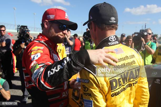 Dale Earnhardt Jr driver of the AXALTA Chevrolet and Matt Kenseth driver of the DeWalt Hurricane Relief Toyota take part in prerace ceremonies for...