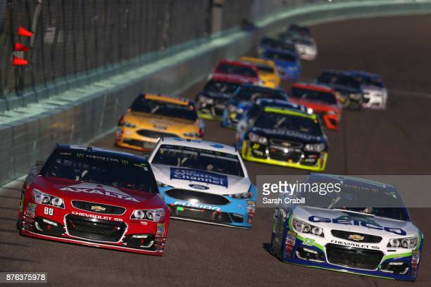 Dale Earnhardt Jr driver of the AXALTA Chevrolet and Ty Dillon driver of the GEICO Chevrolet lead a pack of cars during the Monster Energy NASCAR Cup...