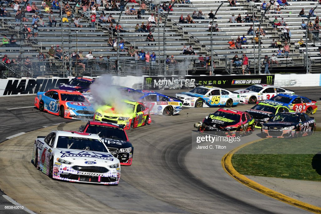 Dale Earnhardt Jr., driver of the #88 Axalta Chevrolet, Aric Almirola, driver of the #43 STP Ford, wreck during the Monster Energy NASCAR Cup Series STP 500 at Martinsville Speedway on April 2, 2017 in Martinsville, Virginia.