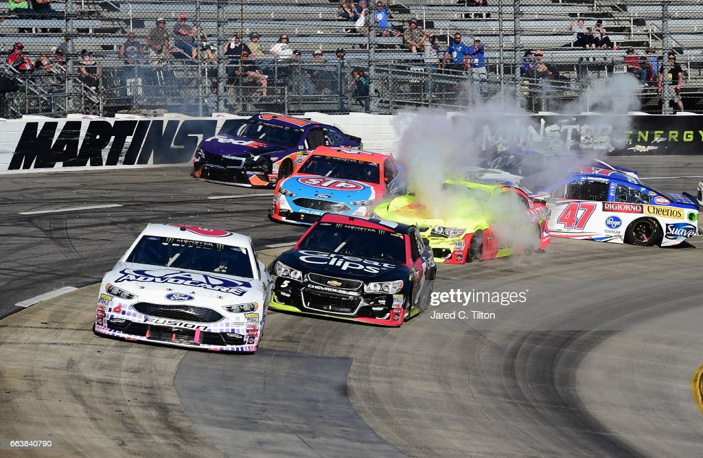 Dale Earnhardt Jr., driver of the #88 Axalta Chevrolet, Aric Almirola, driver of the #43 STP Ford, Ty Dillon, driver of the #13 GEICO Chevrolet, Landon Cassill, driver of the #34 FR8 Auctions Ford, and Denny Hamlin, driver of the #11 FedEx Express Toyota, wreck during the Monster Energy NASCAR Cup Series STP 500 at Martinsville Speedway on April 2, 2017 in Martinsville, Virginia.