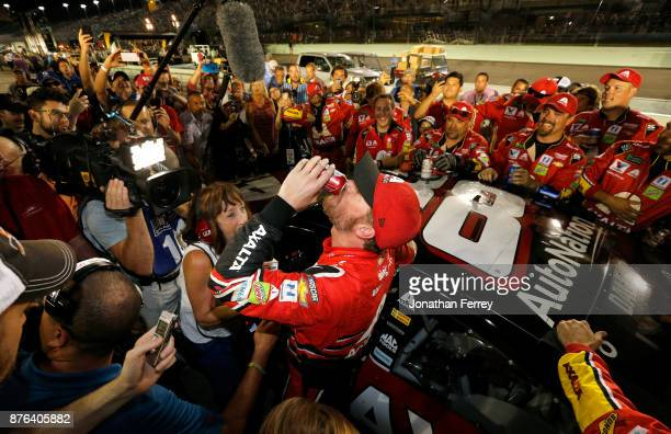 Dale Earnhardt Jr driver of the AXALTA Chevrolet celebrates with teammates after his final cup series race the Monster Energy NASCAR Cup Series...
