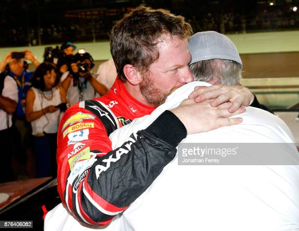 Dale Earnhardt Jr., driver of the AXALTA Chevrolet, celebrates with team owner Rick Hendrick after his final cup series race, the Monster Energy...