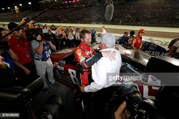 Dale Earnhardt Jr driver of the AXALTA Chevrolet celebrates with team owner Rick Hendrick after his final cup series race the Monster Energy NASCAR...
