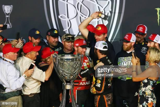 Dale Earnhardt Jr driver of the AXALTA Chevrolet congratulates Martin Truex Jr driver of the Bass Pro Shops/Tracker Boats Toyota in Victory Lane...