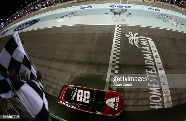Dale Earnhardt Jr driver of the AXALTA Chevrolet crosses the finishline to place 25th in the Monster Energy NASCAR Cup Series Championship Ford...