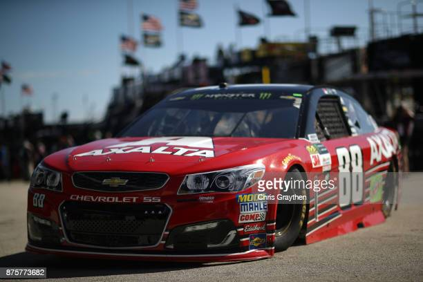 Dale Earnhardt Jr driver of the AXALTA Chevrolet drives through the garage area during practice for the Monster Energy NASCAR Cup Series Championship...