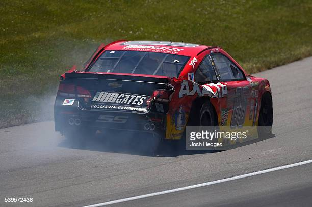 Dale Earnhardt Jr driver of the Axalta Chevrolet drives to pit road after an ontrack incident during the NASCAR Sprint Cup Series FireKeepers Casino...