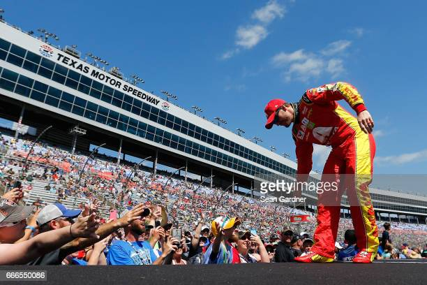 Dale Earnhardt Jr driver of the Axalta Chevrolet greets fans during driver introductions prior to the Monster Energy NASCAR Cup Series O'Reilly Auto...