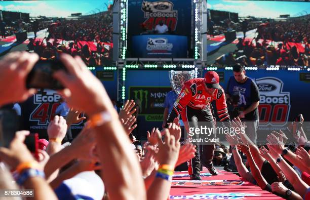Dale Earnhardt Jr driver of the AXALTA Chevrolet greets fans during driver introductions for the Monster Energy NASCAR Cup Series Championship Ford...