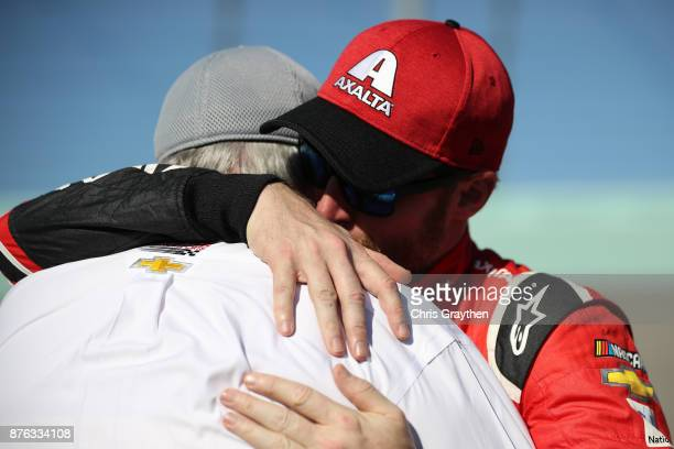 Dale Earnhardt Jr driver of the AXALTA Chevrolet hugs Rick Hendrick during prerace ceremonies for the Monster Energy NASCAR Cup Series Championship...