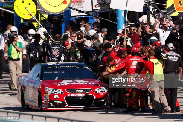 Dale Earnhardt Jr driver of the AXALTA Chevrolet is greeted by crew members as he drives on pit road prior to the Monster Energy NASCAR Cup Series...