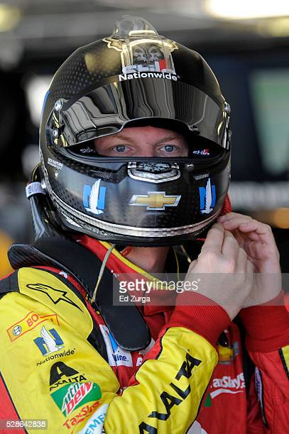 Dale Earnhardt Jr., driver of the Axalta Chevrolet, looks on during practice for the NASCAR Sprint Cup Series Go Bowling 400 at Kansas Speedway on...