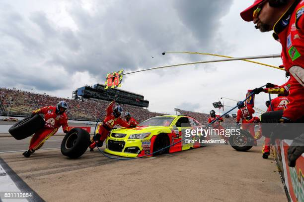 Dale Earnhardt Jr driver of the Axalta Chevrolet pits during the Monster Energy NASCAR Cup Series Pure Michigan 400 at Michigan International...