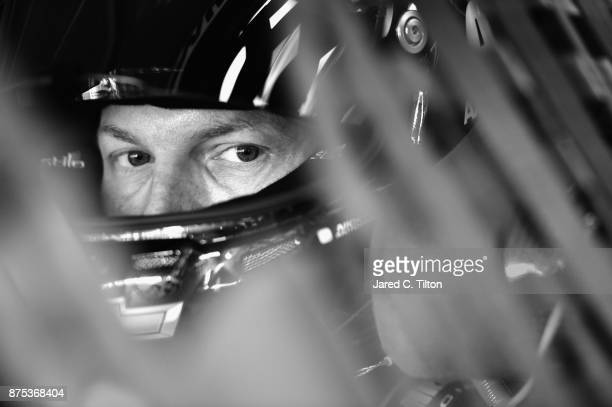 Dale Earnhardt Jr driver of the AXALTA Chevrolet sits in his car during practice for the Monster Energy NASCAR Cup Series Championship Ford EcoBoost...