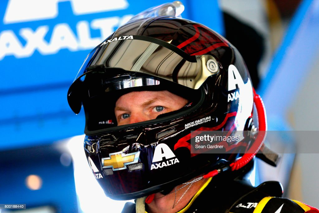 Dale Earnhardt Jr., driver of the #88 Axalta Chevrolet, stands in the garage during practice for the Monster Energy NASCAR Cup Series Toyota/Save Mart 350 at Sonoma Raceway on June 23, 2017 in Sonoma, California.