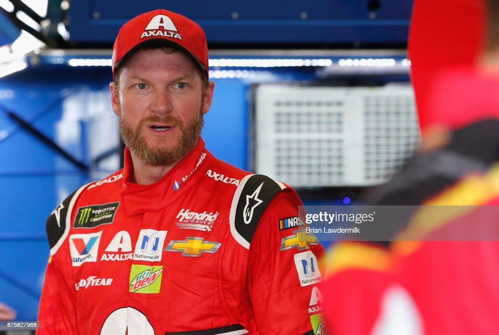 Dale Earnhardt Jr., driver of the #88 AXALTA Chevrolet, stands in the garage area during practice for the Monster Energy NASCAR Cup Series Championship Ford EcoBoost 400 at Homestead-Miami Speedway on November 18, 2017 in Homestead, Florida.