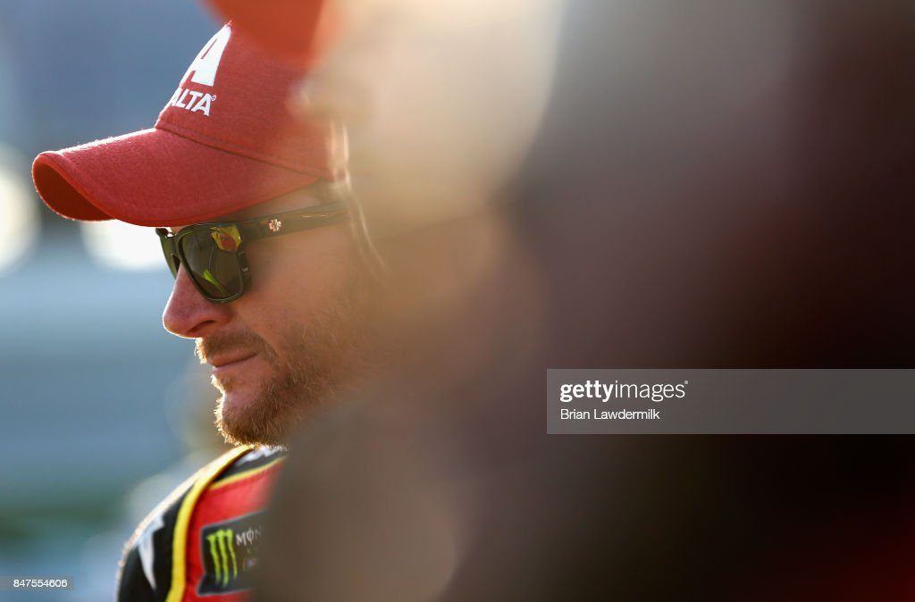 Dale Earnhardt Jr., driver of the #88 AXALTA Chevrolet, stands on the grid during qualifying for the Monster Energy NASCAR Cup Series Tales of the Turtles 400 at Chicagoland Speedway on September 15, 2017 in Joliet, Illinois.