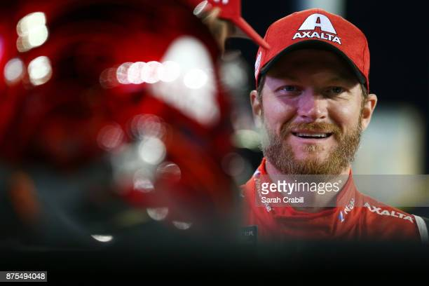 Dale Earnhardt Jr driver of the AXALTA Chevrolet stands on the grid during qualifying for the Monster Energy NASCAR Cup Series Championship Ford...