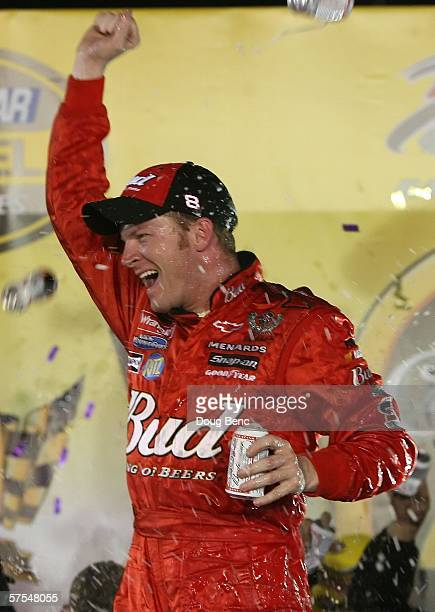 Dale Earnhardt Jr., driver of the Budweiser Chevrolet car, celebrates with a can of Budweiser beer after winning the NASCAR Nextel Cup Series Crown...