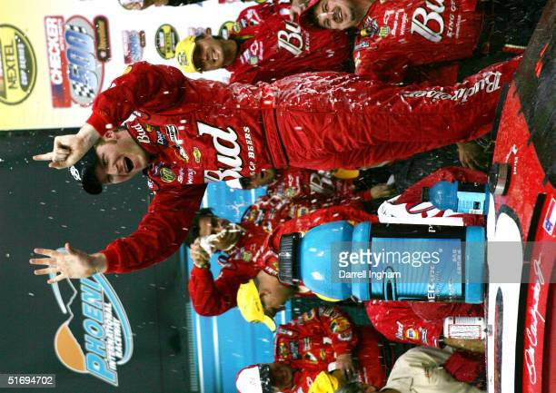 Dale Earnhardt Jr driver of the Budweiser Chevrolet celebrates his sixth win of the season at the NASCAR Nextel Cup Checker Auto Parts 500 on...