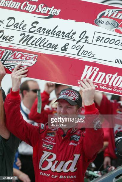 Dale Earnhardt Jr driver of the Budweiser Chevrolet celebrates in victory lane after winning the NASCAR Winston Cup Series EA Sports 500 on October 6...