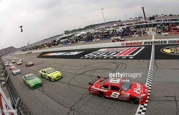 Dale Earnhardt Jr., driver of the Budweiser Chevrolet, crosses the start/finish line during the NASCAR Nextel Cup Series Dodge Avenger 500 on May 13,...