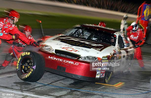 Dale Earnhardt Jr driver of the Budweiser Chevrolet during a pit stop in the Bud Shootout in the NASCAR Nextel Cup Daytona 500 on February 12 2005 at...