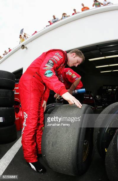 Dale Earnhardt Jr., driver of the Budweiser Chevrolet, inspects his tires during practice for the NASCAR Nextel Cup Daytona 500 on February 16, 2005...