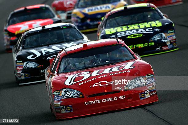 Dale Earnhardt Jr., driver of the Budweiser Chevrolet, leads Clint Bowyer, driver of the Jack Daniel's Chevrolet and Casey Mears, driver of the...