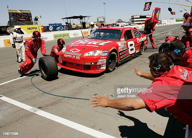 Dale Earnhardt Jr., driver of the Budweiser Chevrolet, makes a pit stop, during the NASCAR Nextel Cup Series Toyota/Save Mart 350 at Infineon Raceway...