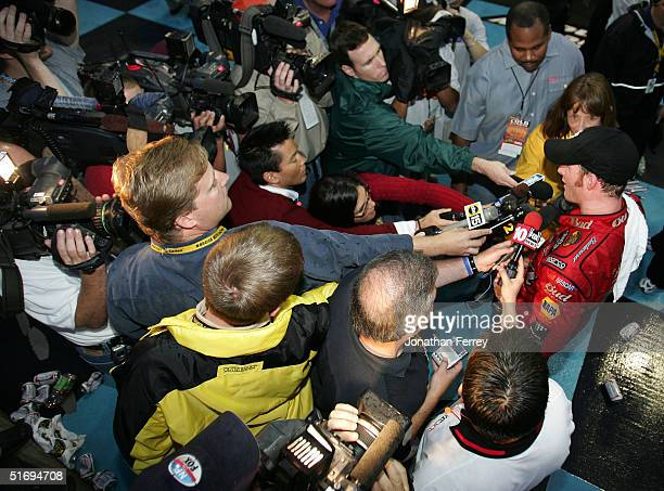 Dale Earnhardt Jr driver of the Budweiser Chevrolet meets the press after he wins the NASCAR Nextel Cup Checker Auto Parts 500 on November 7 2004 at...
