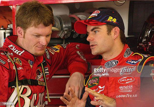 Dale Earnhardt Jr driver of the Budweiser Chevrolet Monte Carlo and Jeff Gordon driver of the Dupont Chevrolet Monte Carlo share a few words during...
