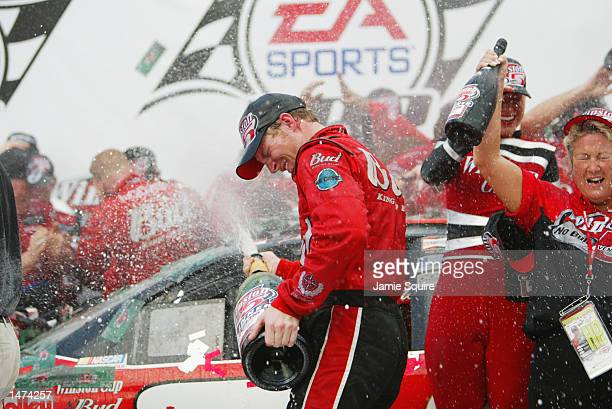 Dale Earnhardt Jr driver of the Budweiser Chevrolet Monte Carlo celebrates in victory lane with champagne after winning the NASCAR Winston Cup EA...