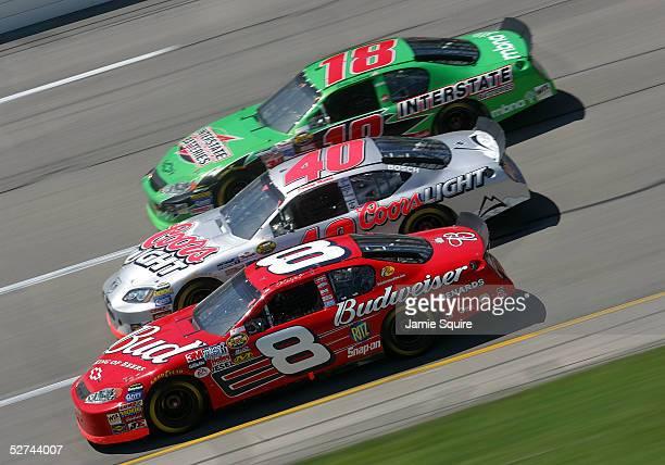 Dale Earnhardt, Jr., driver of the Budweiser Chevrolet, races alongside Sterling Marlin, driver of the Ganassi Racing Dodge and Bobby Labonte, driver...