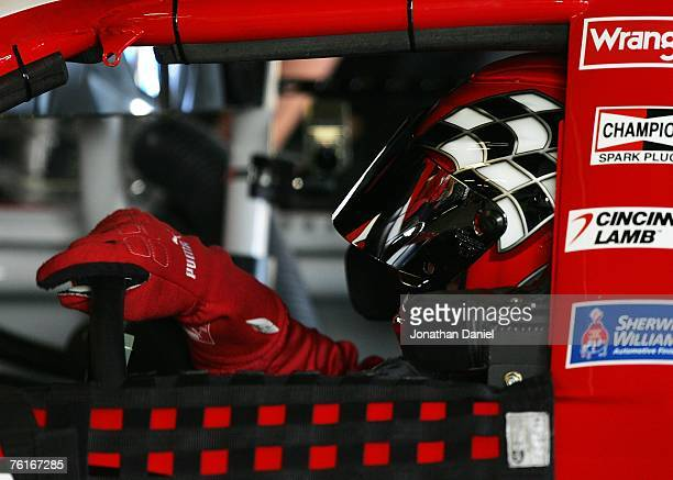 Dale Earnhardt Jr., driver of the Budweiser Chevrolet, sits in his car in the garage prior to practice for the NASCAR Nextel Cup Series 3M...