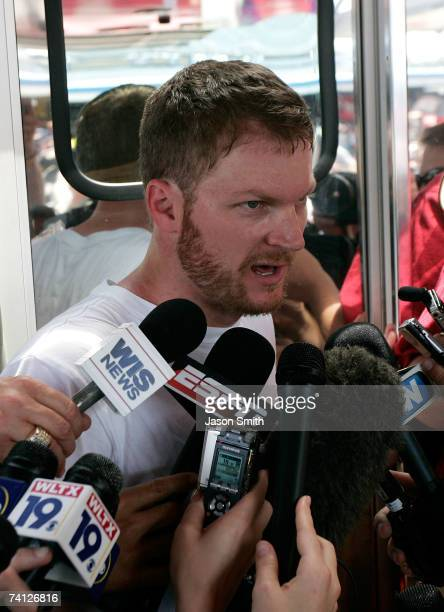 Dale Earnhardt Jr., driver of the Budweiser Chevrolet, speaks with members of the media at his hauler following practice for the NASCAR Nextel Cup...