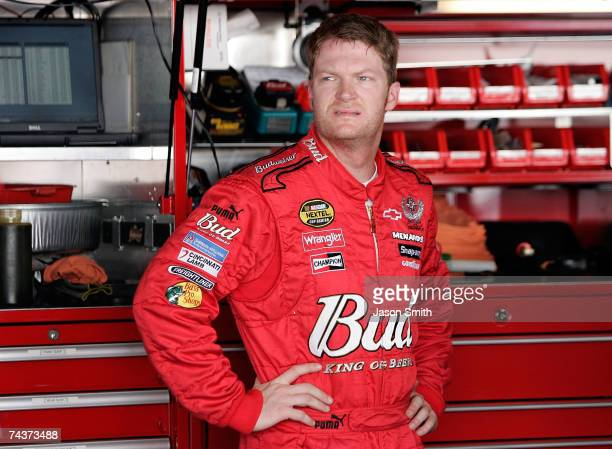 Dale Earnhardt Jr., driver of the Budweiser Chevrolet, stands in the garage during practice for the NASCAR Nextel Cup Series Autism Speaks 400 on...