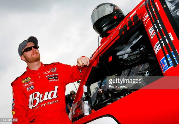 Dale Earnhardt Jr., driver of the Budweiser Chevrolet, stands next to his car prior to the NASCAR Nextel Cup Series Dodge Avenger 500 on May 13, 2007...