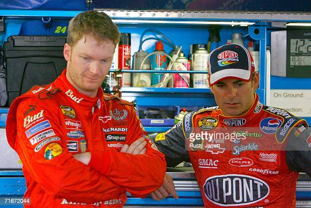 Dale Earnhardt Jr., driver of the Budweiser Chevrolet, talks with Jeff Gordon, driver of the DuPont Chevrolet, in the garage during practice for the...