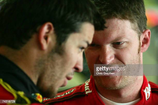 Dale Earnhardt Jr., driver of the Budweiser Chevrolet, talks with Martin Truex Jr., driver of the Bass Pro Shops Chevrolet, during practice for the...