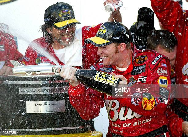 Dale Earnhardt Jr driver of the DEI Budweiser Chevrolet celebrates by spraying champagne in victory circle after winning the the NASCAR Nextel Cup...